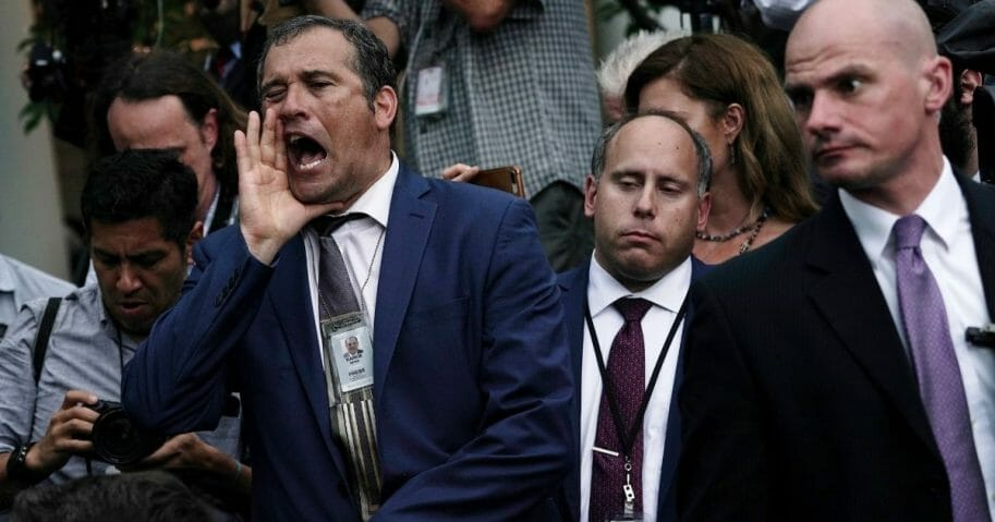 Brian Karem of Playboy Magazine argues with conservative military and intelligence analyst and former deputy assistant to President Donald Trump Sebastian Gorka (not pictured) after the President made a Rose Garden statement on the census July 11, 2019, at the White House in Washington, D.C.