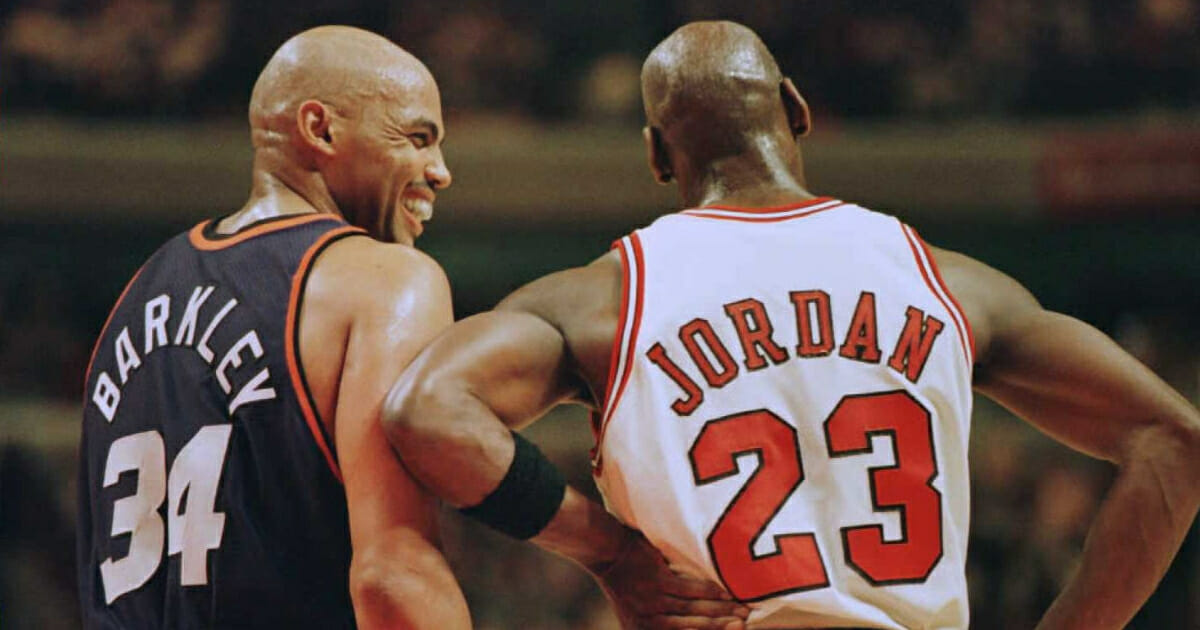 Charles Barkley, left, laughs at a foul call with Michael Jordan during a 1996 game between the Phoenix Suns and Chicago Bulls.