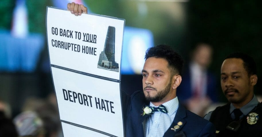Democratic Virginia state Del. Ibraheem Samirah holds up a sign.