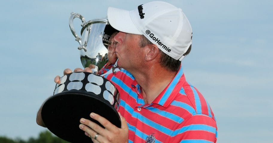 PGA Tour player Jim Herman kisses trophy