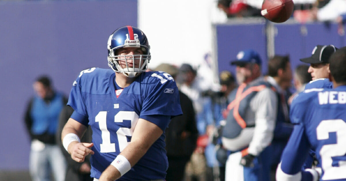 Then-Giants quarterback Jared Lorenzen warms up on the sidelines before the New York Giants beat the Texans 14 to 10 on Nov. 5, 2006 at The Meadowlands in East Rutherford, New Jersey.