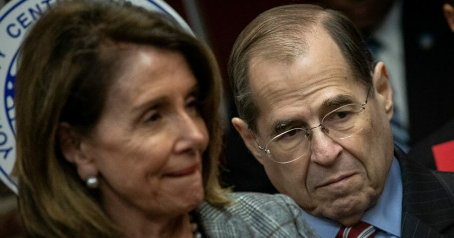 Speaker of the House Nancy Pelosi of California, left, and House Judiciary Committee Chairman Rep. Jerrold Nadler of New York observe during a news conference to discuss the American Dream and Promise Act at the Tenement Museum, March 20, 2019, in New York City.