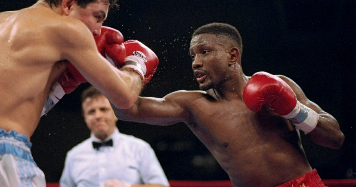 Pernell Whitaker throws a punch at Julio Cesar Vasquez.