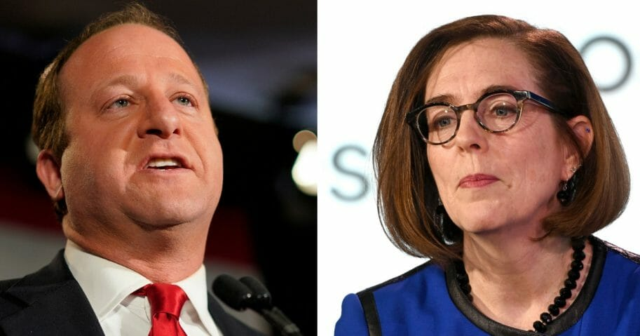 Gov. Jared Polis, left, of Colorado and Gov. Kate Brown, right, of Oregon, both Democrats.