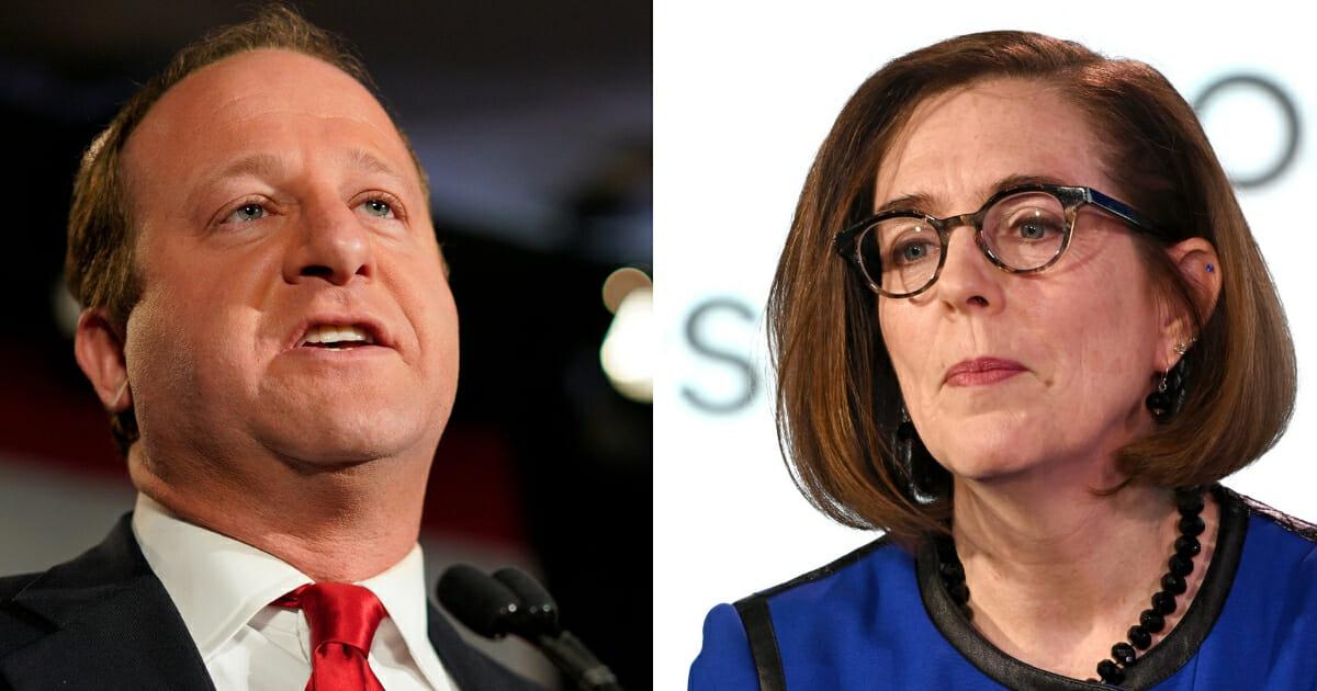 Gov. Jared Polis, left, of Colorado and Gov. Kate Brown, right, of Oregon, both Democrats.
