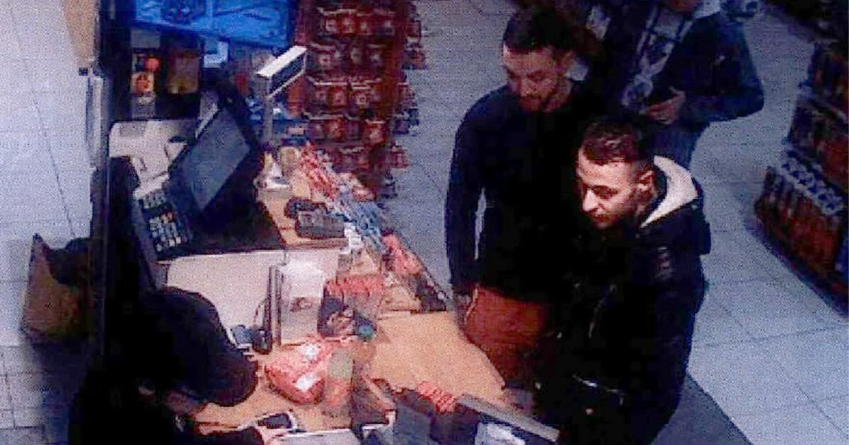 This video image taken from a CCTV camera at a petrol station in Ressons, France, shows Mohammed Abrini, left, and Salah Abdeslam buying goods.
