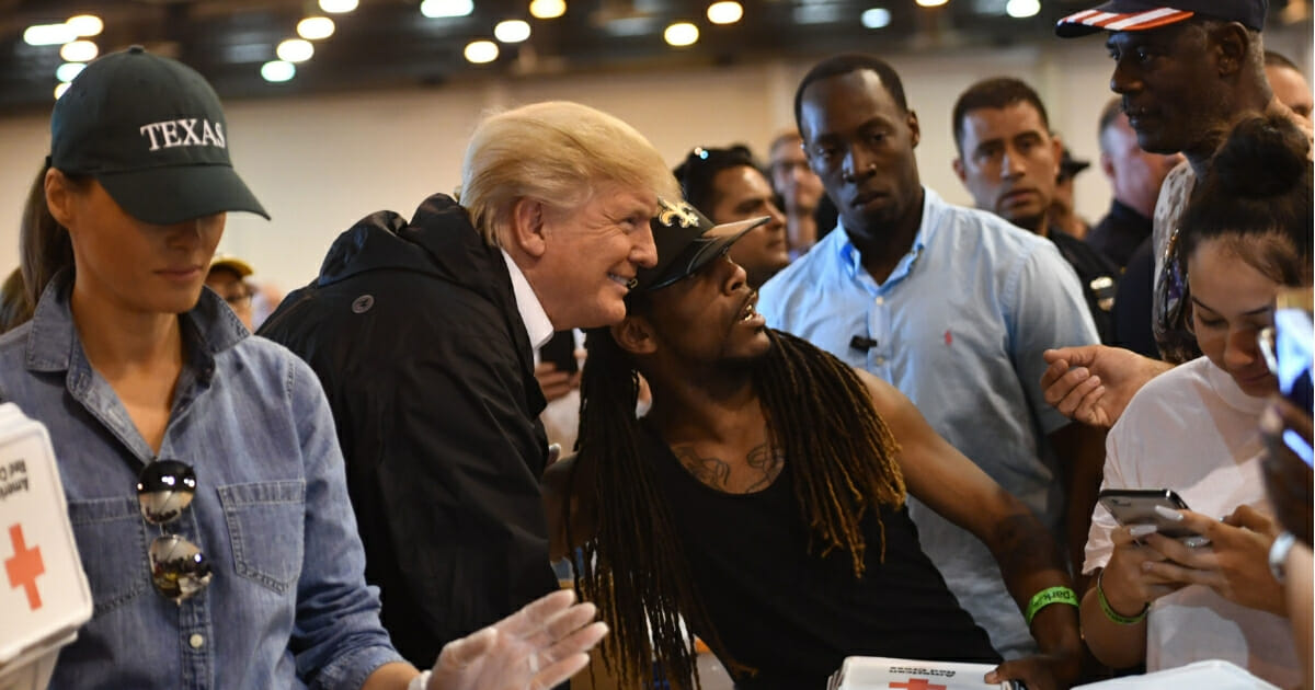 President Donald Trump and first lady Melania Trump serve food to victims of Hurricane Harvey at NRG Center in Houston.