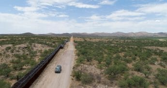 A Green Valley-Sahuarita Samaritans vehicle patrols the border fence in Sasabe, Arizona, on July 14, 2019.
