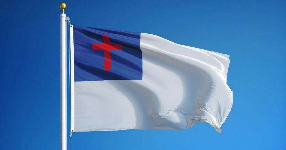 Christian flag - white with a red cross on a blue background in the upper left corner.
