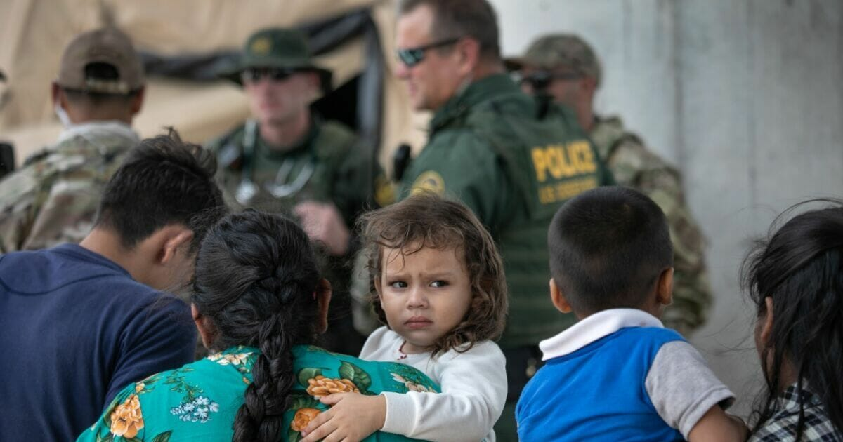 Immigrants are taken into custody by Border Patrol agents in McAllen, Texas