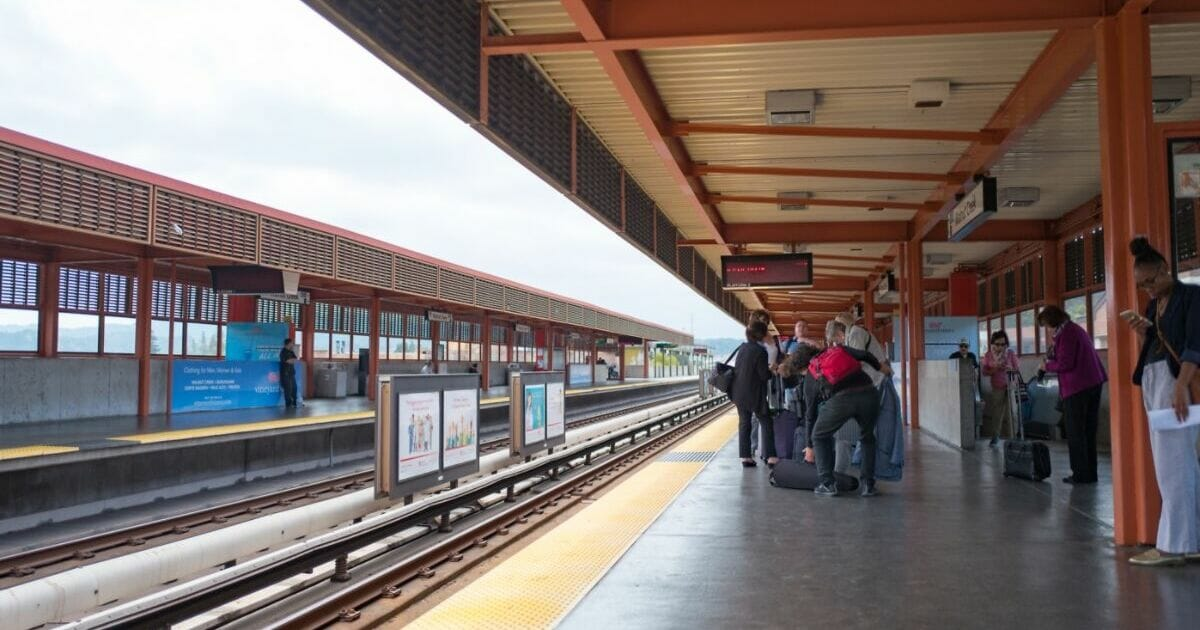 Riders line up and wait for a train to San Francisco at the Walnut Creek, California station of the Bay Area Rapid Transit light rail system