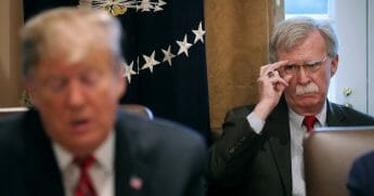 National Security Adviser John Bolton listens to U.S. President Donald Trump talk to reporters during a meeting of his cabinet in the Cabinet Room at the White House February 12, 2019