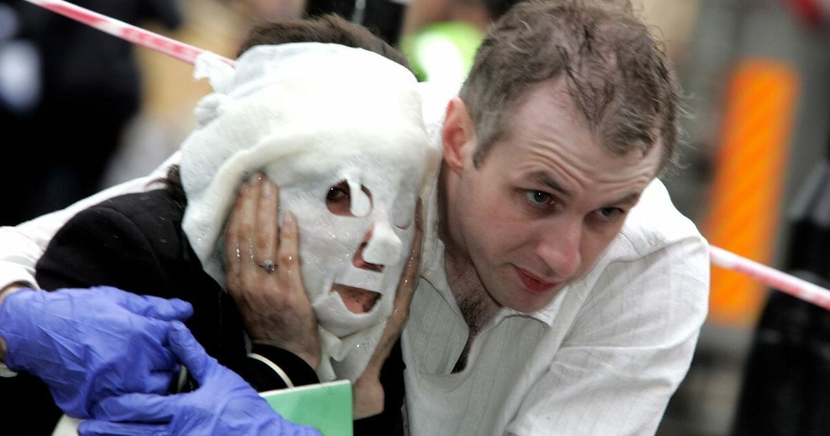 Londoners seek shelter after a series of terrorist attacks on July 7, 2005