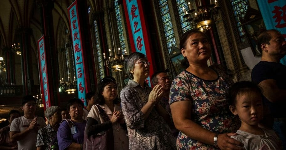 Chinese Catholics worship at a church in Beijing
