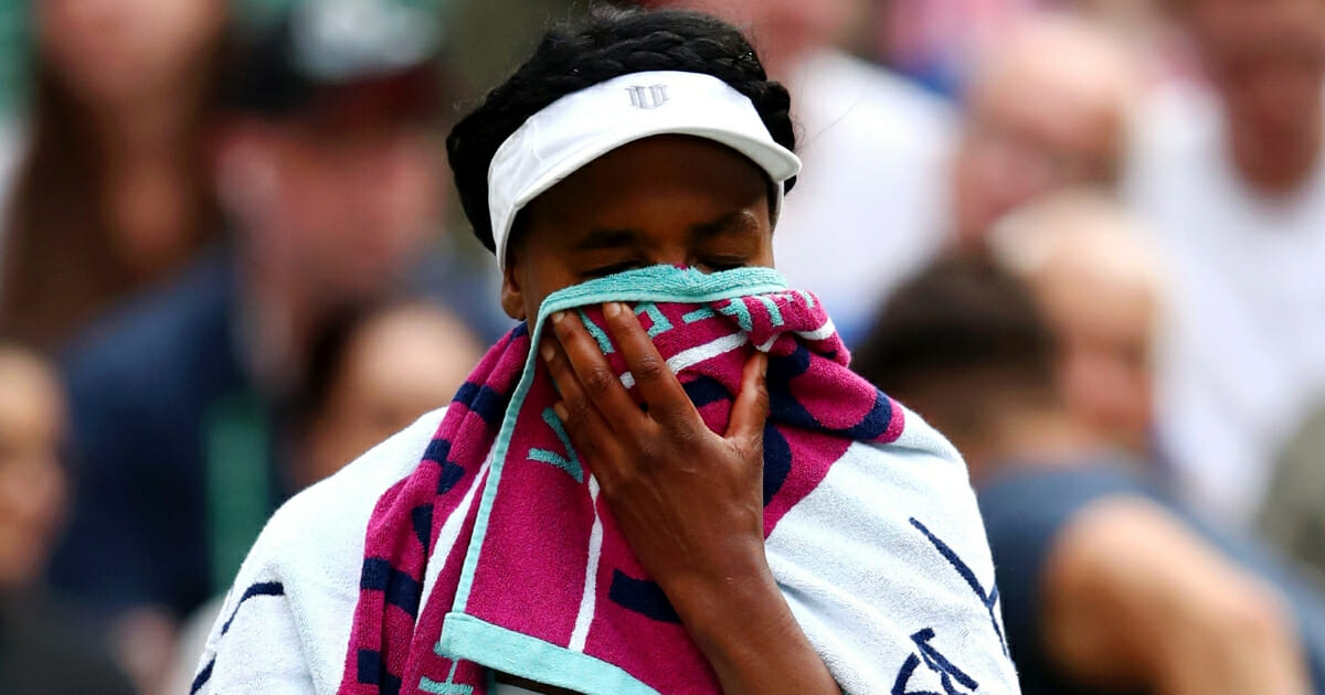 Venus Williams puts a towel over her face between games in her first-round match against 15-year-old Cori Gauff at Wimbledon.