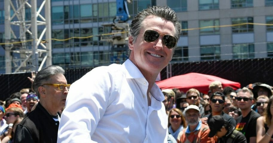 Gov. Gavin Newsom rides during the San Francisco Pride Parade.