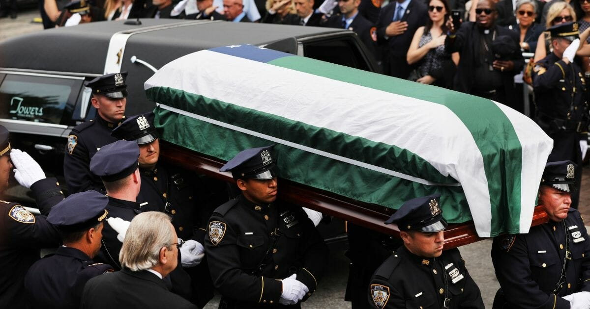 The casket of retired NYPD detective Luis Alvarez is brought into Immaculate Conception Church on July 03, 2019 in the Queens borough of New York City.
