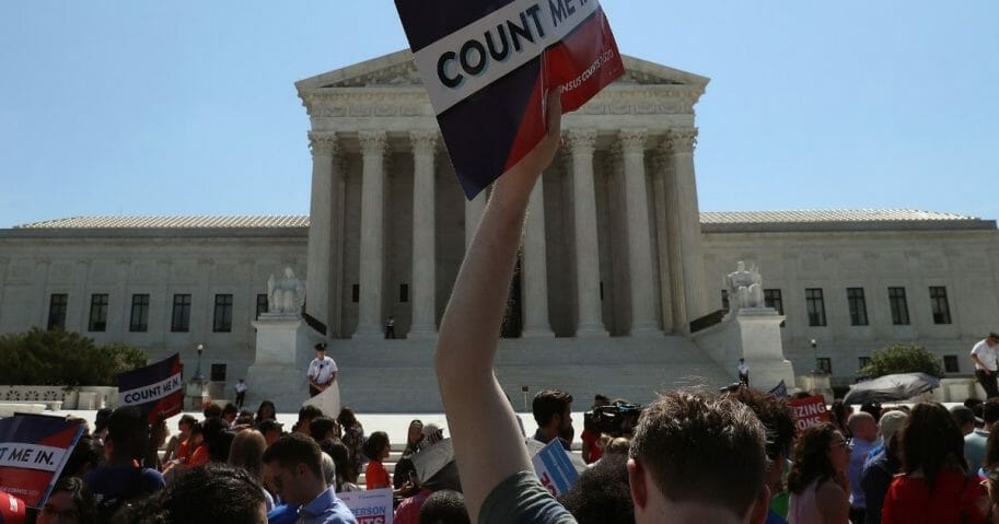 People gather in front of the U.S. Supreme Court after several decisions were handed down on June 27, 2019 in Washington, D.C.