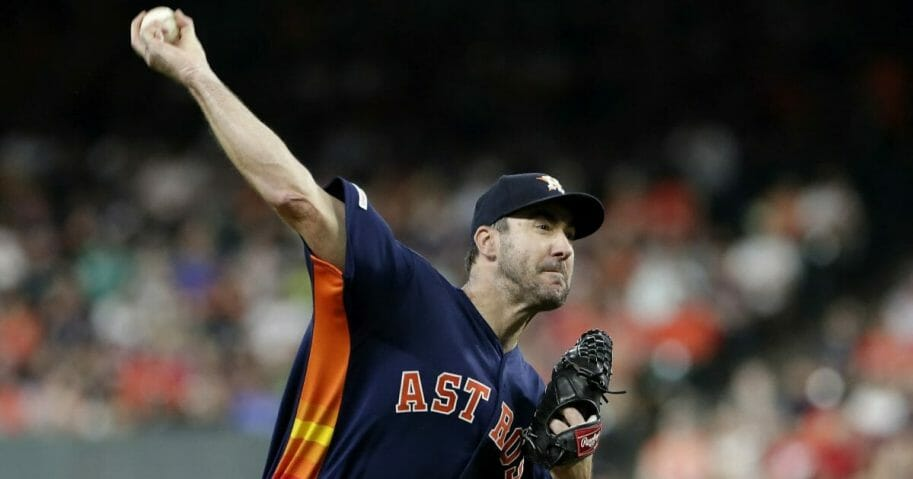 Houston Astros starting pitcher Justin Verlander throws during the first inning of a baseball game against the Seattle Mariners.