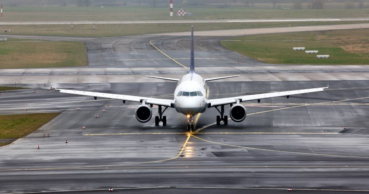 Airplane grounded by stormy weather.