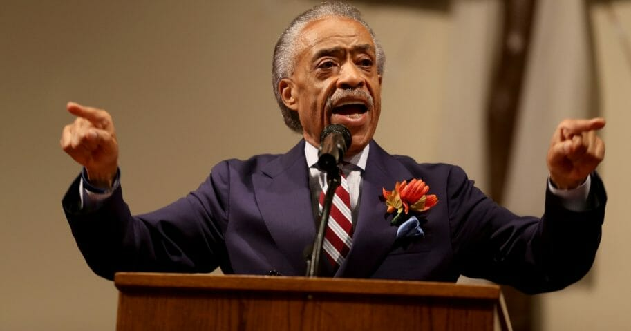 The Rev. Al Sharpton speaks to parishioners at the Greater St. Marks Family Church as the community seeks answers about the police shooting of Michael Brown on Aug. 17, 2014, in Ferguson, Missouri.