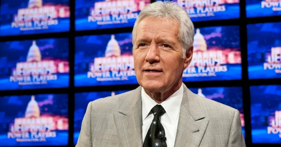 "Alex Trebek speaks during a rehearsal before a taping of ""Jeopardy!"" at DAR Constitution Hall on April 21, 2012, in Washington, D.C."