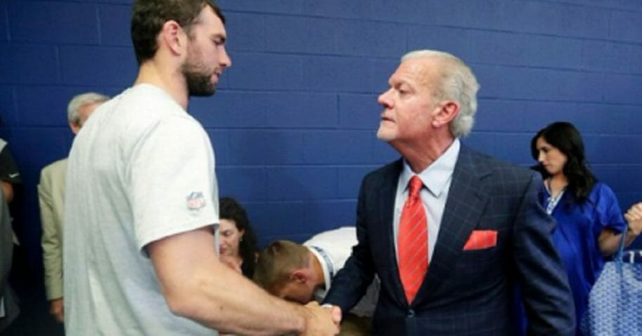 Retiring NFL quarterback Andrew Luck, left, shakes hands with Indianopolis Colts owner Jim Irsay on Saturday.