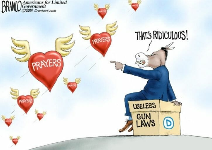 Democrat Donkey sits on a box of gun laws and points to hearts of prayers