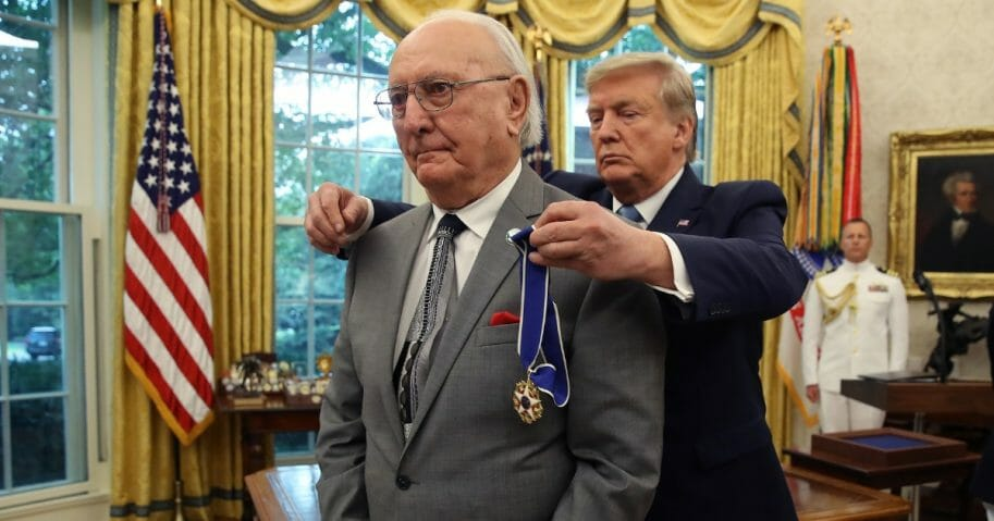 President Donald Trump presents the Medal of Freedom to retired Boston Celtic Bob Cousy in the Oval Office at the White House on Aug. 22, 2019.