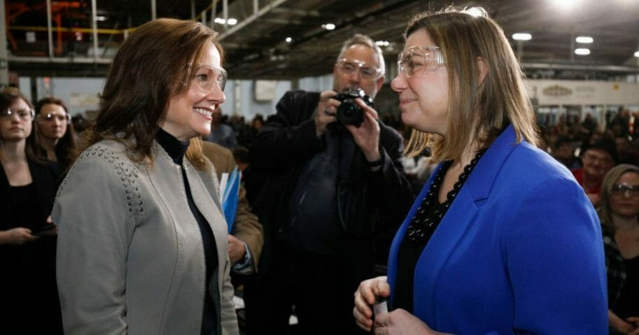 General Motors CEO Mary Barra, left, speaks with Michigan Rep. Elissa Slotkin on March 22, 2019, in Lake Orion, Mich.