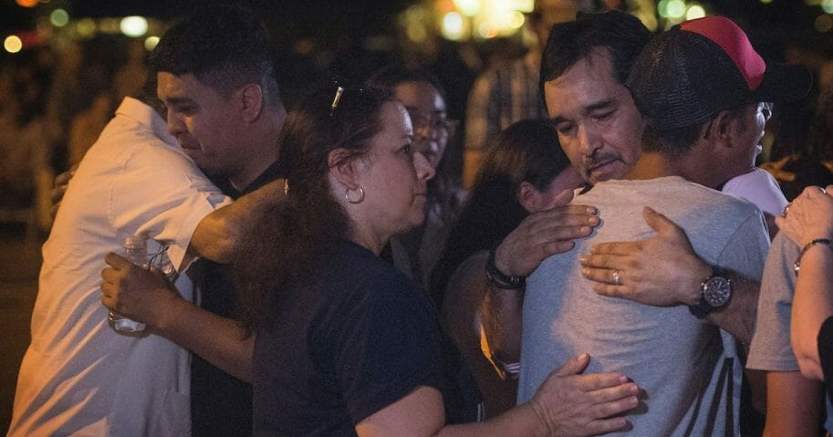 Families of Walmart shooting in El Paso embrace.