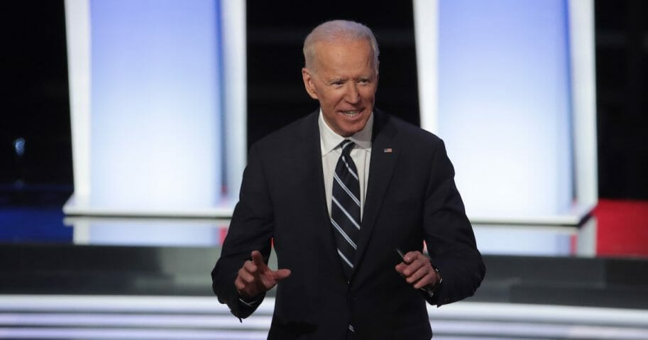 Former Vice President Joe Biden stands on stage after the Democratic presidential debate at the Fox Theatre in Detroit on Wednesday.