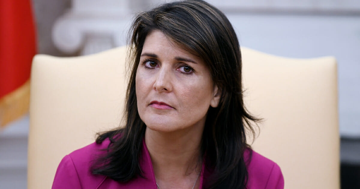 Nikki Haley, then the United States ambassador to the United Nations, looks on during a meeting with President Donald Trump in the Oval office of the White House on Oct. 9, 2018 in Washington, D.C.