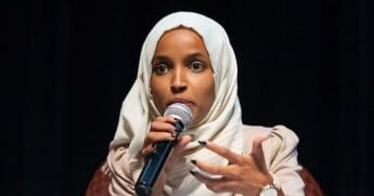 Rep. Ilhan Omar speaks on stage during a town hall meeting at Sabathani Community in Minneapolis in July.