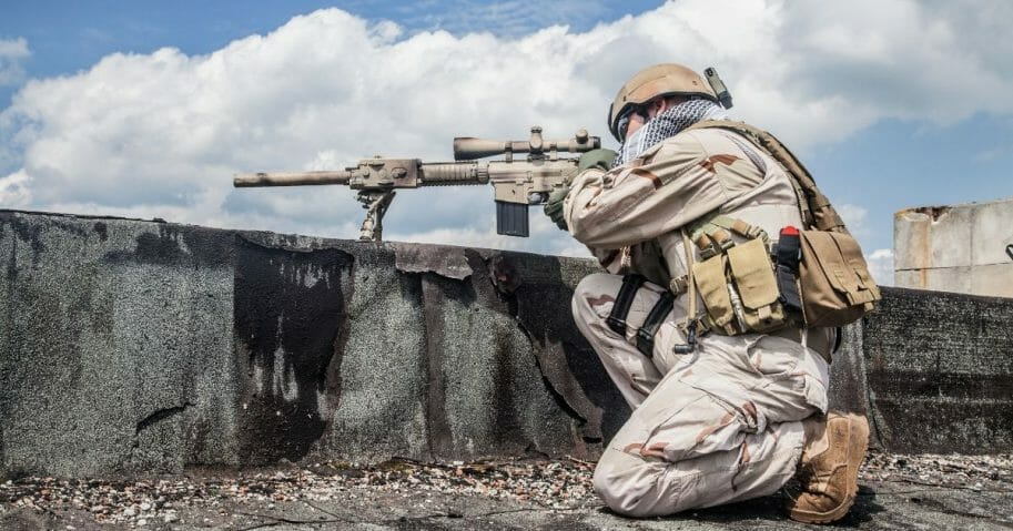 A member of a Navy SEAL Team in action