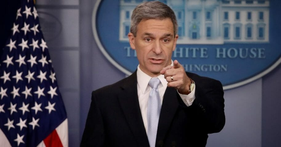 Ken Cuccinelli, acting director of U.S. Citizenship and Immigration Services, fields questions Monday about new rules that will limit immigrants eligibility for green cards if they are unable to support themselves.