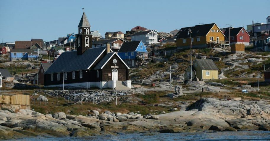 Zion Lutheran Church, built in 1779, stands on Disko Bay in Ilulissat, Greenland