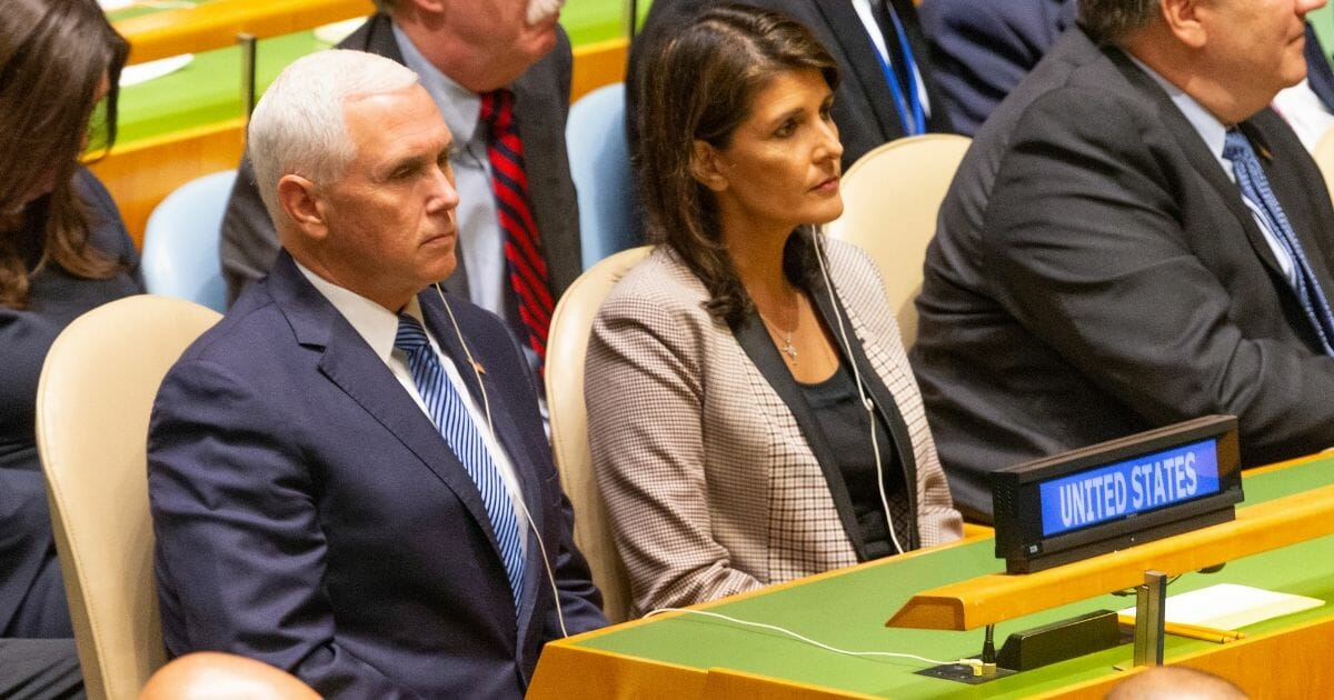 Vice President Mike Pence and then-United Nations Ambassador Nikki Haley listen as President Donald Trump addresses the U.N. in September 2018.