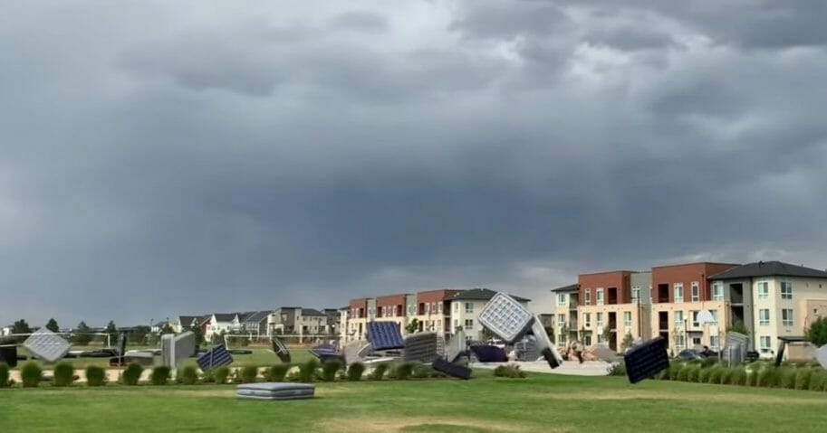 "Storm Causes Massive Mattress Migration || ViralHog Occurred on August 17, 2019 / Colorado, USA ""We were hanging out by the pool and apparently they were setting up for 'movie night under the stars' with pillows and mattresses and then a storm rolled in."" Credit: Robb Manes"