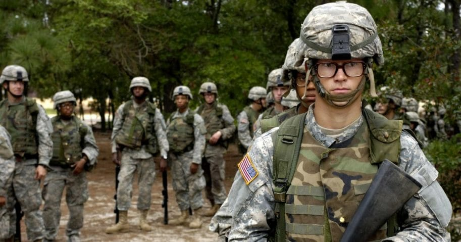 U.S. Army privates wait their turn to go through the convoy live-fire course during Army basic training at Fort Jackson, S.C., Sept. 19, 2006.