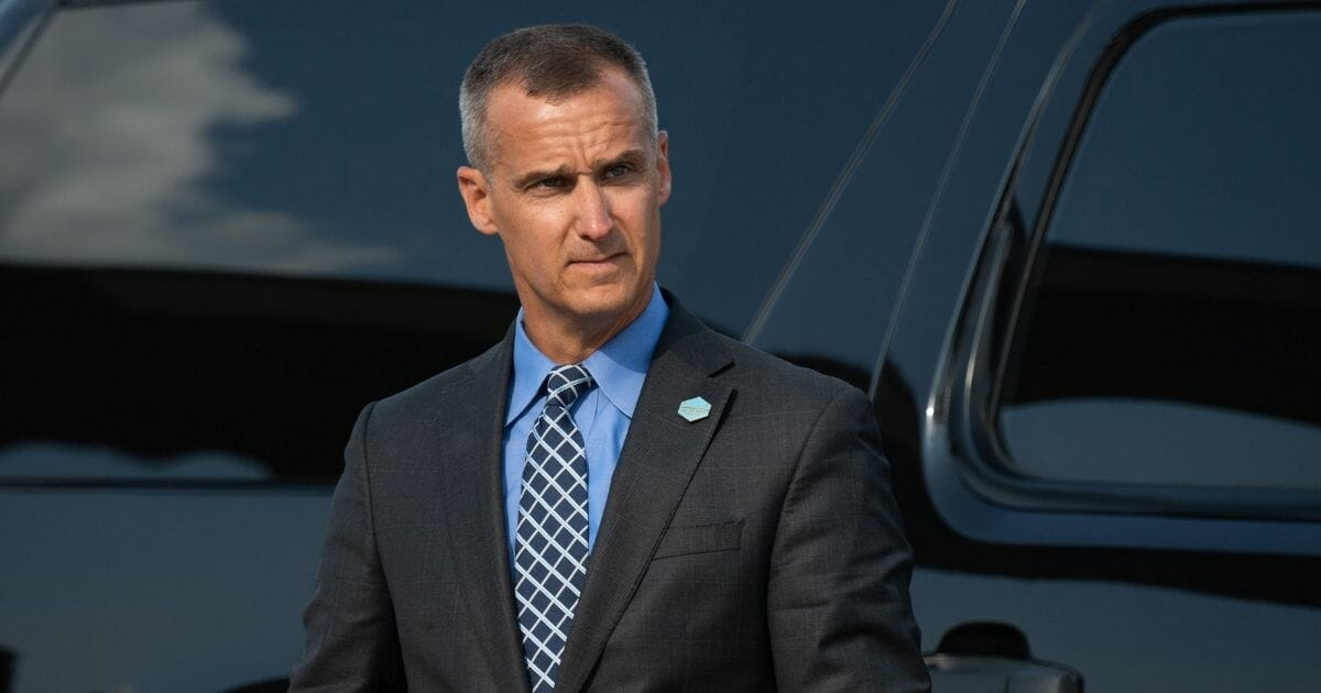 Corey Lewandowski, former campaign manager for US President Donald Trump, watches as Trump disembarks from Air Force One upon arrival at Cincinnati/Northern Kentucky International Airport in Hebron, Kentucky, August 1, 2019.