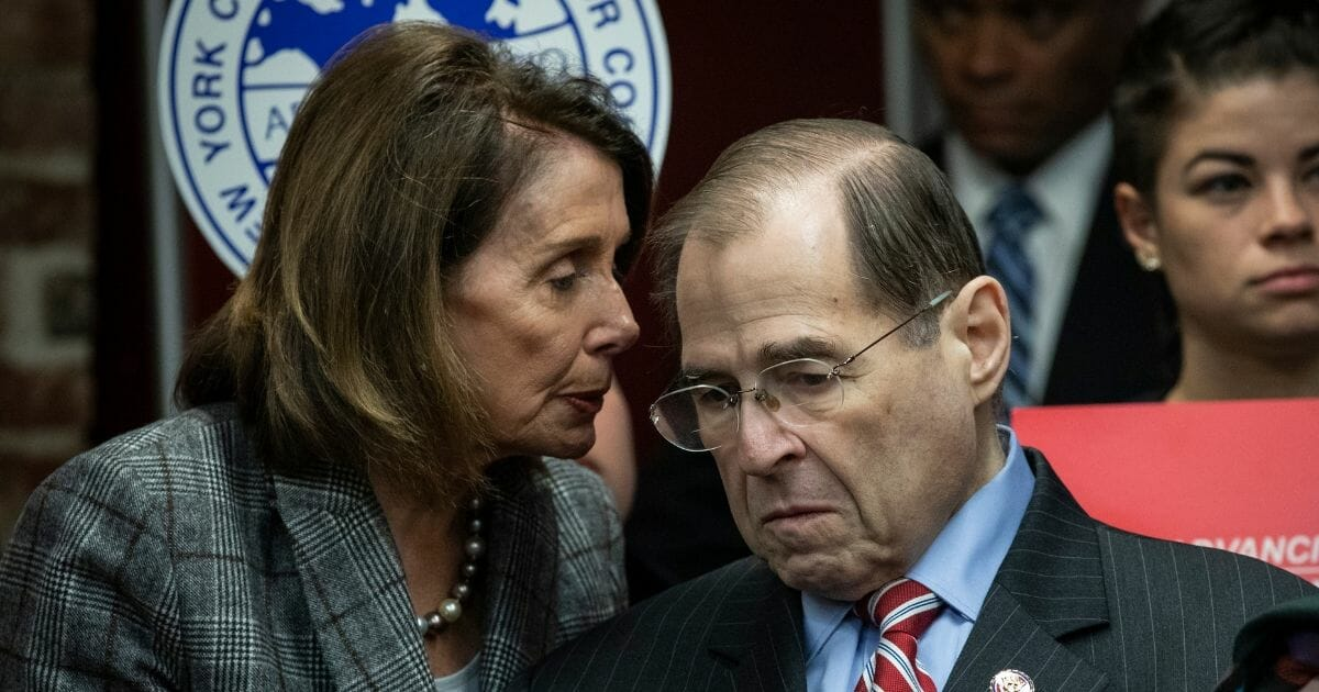 Democratic Speaker of the House Nancy Pelosi, left, speaks with House Judiciary Committee Chairman Rep. Jerrold Nadler, right, during a press conference to discuss the American Dream and Promise Act at the Tenement Museum, March 20, 2019 in New York City.