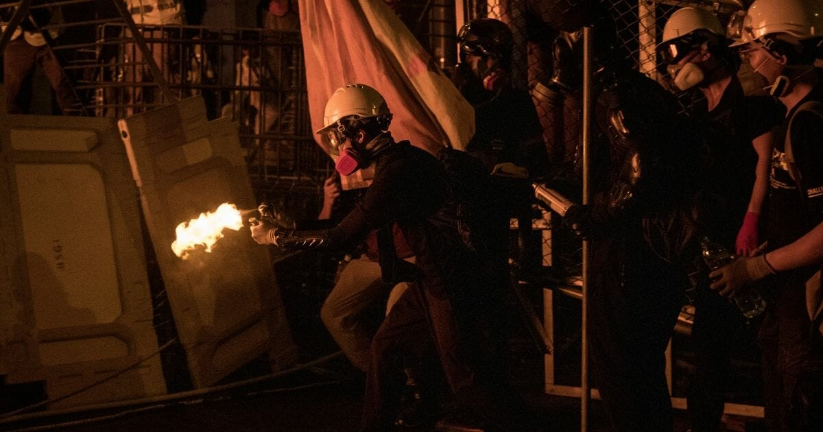 Protesters set fire to a makeshift barricade after clashing with police at an anti-government rally on Aug. 31, 2019 in Hong Kong, China
