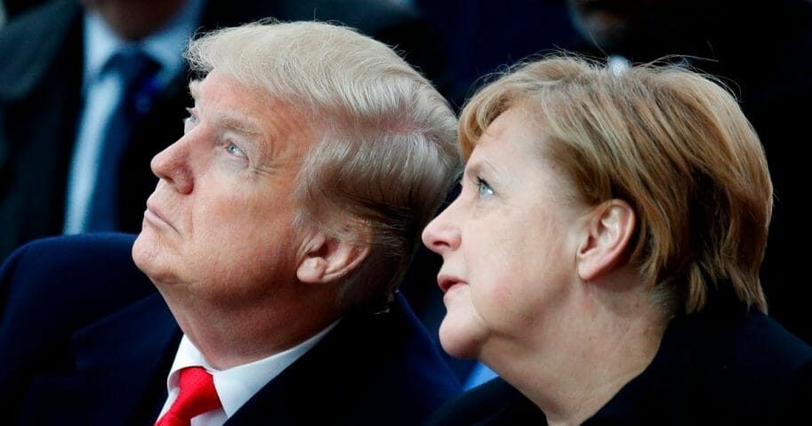 U.S. President Donald Trump, left, and German Chancellor Angela Merkel, right, attend a ceremony at the Arc de Triomphe in Paris on November 11, 2018 as part of commemorations marking the 100th anniversary of the 11 November 1918 armistice, ending World War I.