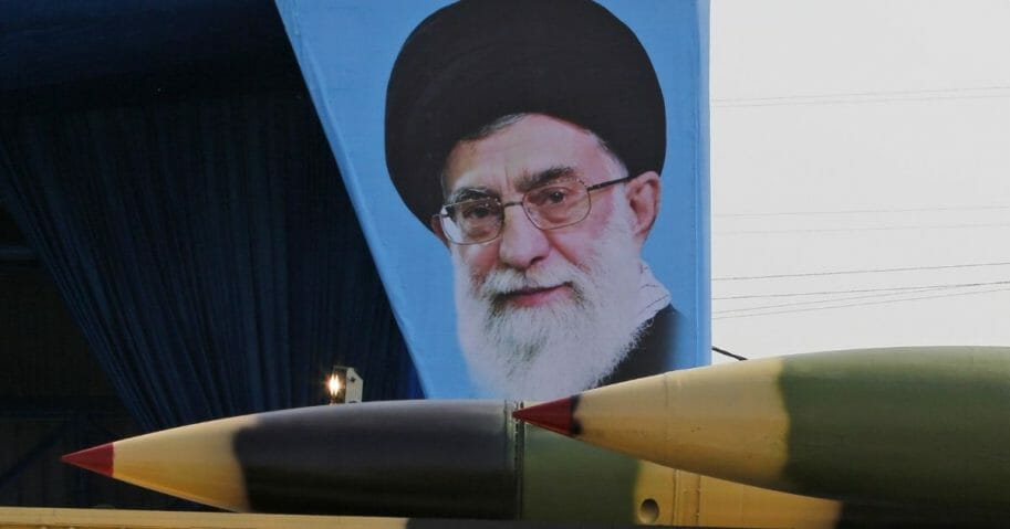 "An Iranian military truck carries surface-to-air missiles past a portrait of Iran's Supreme Leader Ayatollah Ali Khamenei during a parade on the occasion of the country's annual army day on April 18, 2018, in Tehran. President Hassan Rouhani said that Iran ""does not intend any aggression"" against its neighbors but will continue to produce all the weapons it needs for its defense."