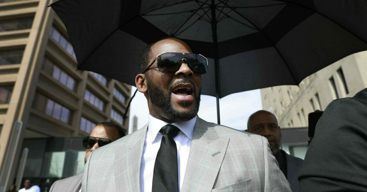 In this Thursday, June 6, 2019, file photo, musician R. Kelly leaves the Leighton Criminal Court building, in Chicago. Kelly is due in a New York City court, Friday, Aug. 2, 2019, for an arraignment on charges he sexually abused women and girls.