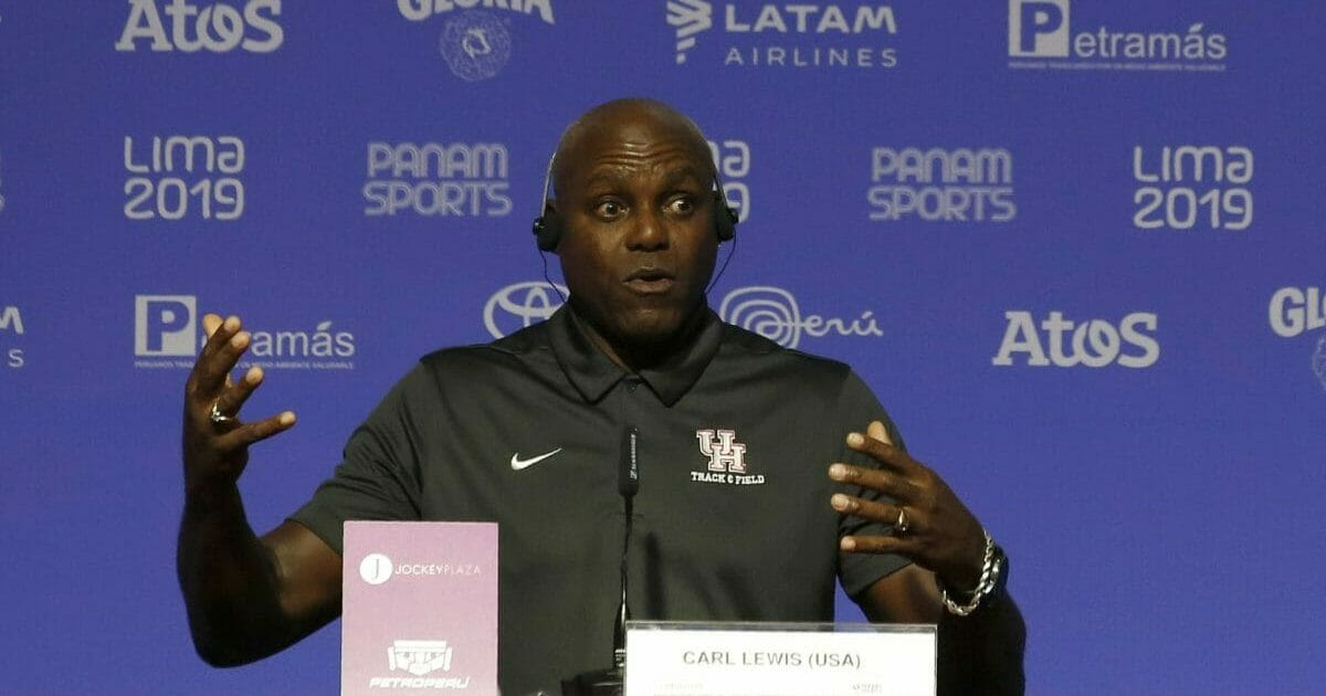 Nine-time Olympic gold medalist Carl Lewis, from the United States, speaks during a press conference during the Pan American Games in Lima, Peru, Monday, Aug. 5, 2019.