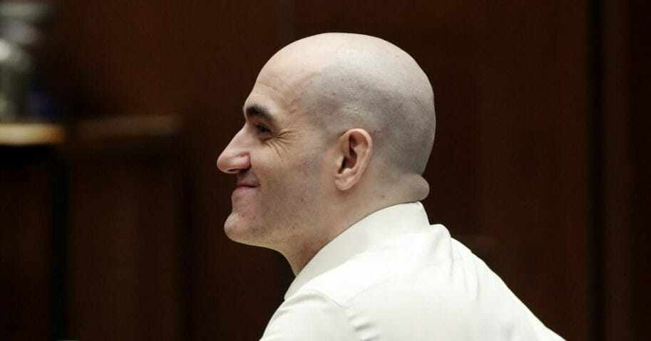 Michael Gargiulo smiles during a court appearance Tuesday, Aug. 6, 2019, in Los Angeles. Closing arguments started Tuesday in the trial of an air conditioning repairman charged with killing two Southern California women and attempting to kill a third.