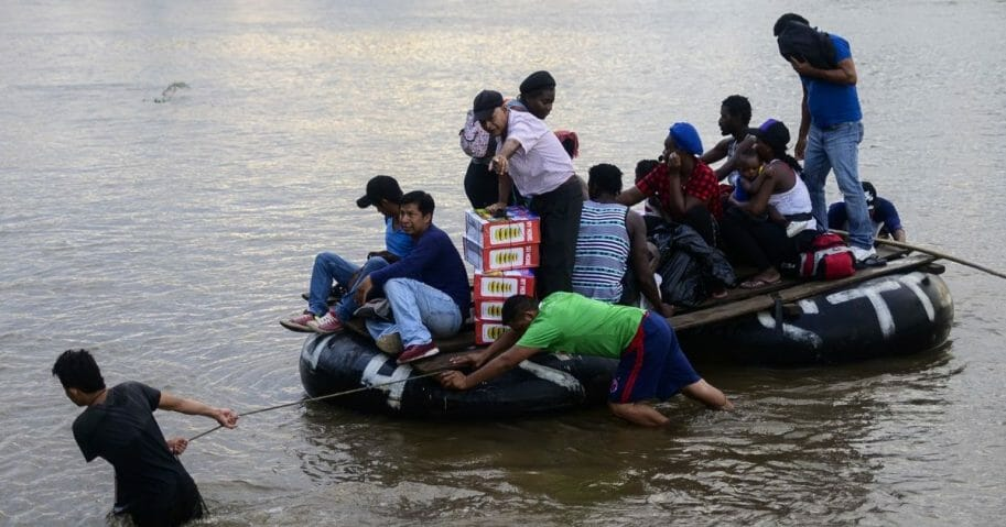 Migrants use a makeshift raft to illegally cross the Suchiate river.
