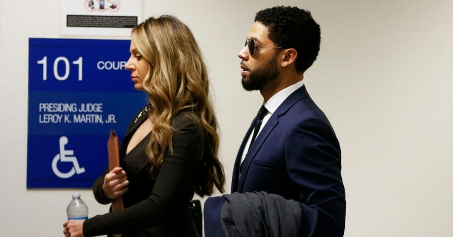 Actor Jussie Smollett (R) and attorney Tina Glandian walk in Leighton Criminal Courthouse for his court appearance on March 14, 2019 in Chicago, Illinois.